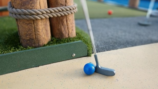 mini golf course with putter and ball